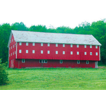 The 1861 Christian Pershing Barn at the Norma Johnson Center located on the Conservation Side is on The National Historic Registry in 1991 by the Department of Interior. This barn contains the architectural features associated with the Switzer Barn type. The building maintains a high degree of historic integrity and is a rare example of this type in Tuscarawas County. Originally from Germany the Pershing Family settled in York County, PA in 1749. He married and took barn building up as a profession. Christian Pershing, JR. lived from 1786-1866.